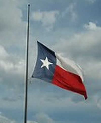 Texas flag at half mast