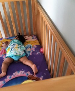 baby in crib at shelter400x481